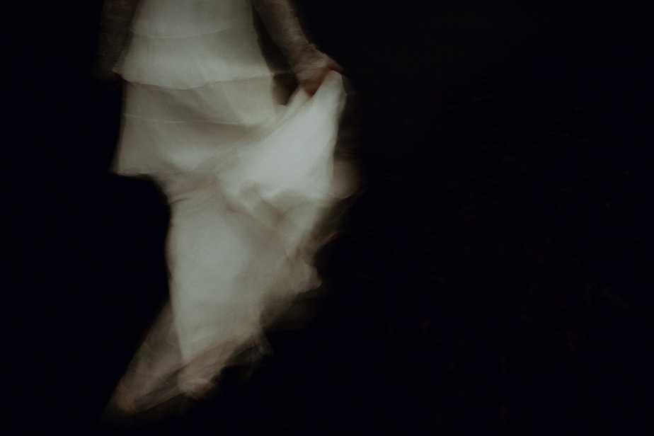 Glasgow Wedding Photographer - bride swishing her dress walking through Glasgow