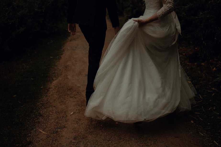 Bride walking with wedding dress by Oban Wedding Photographer, Belle Art Photography