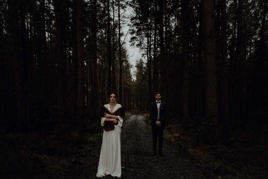 Couple standing next to each other in a forest in Perthshire by Perthshire Wedding Photographer.