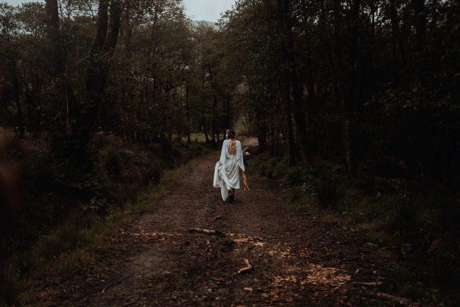 Isle of Jura Wedding Photographer - bride walking through forest to elope on The Isle of Jura.