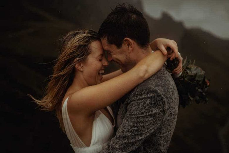 Isle of Skye Elopement. Couple laughing and hugging in the rain on The Isle of Skye