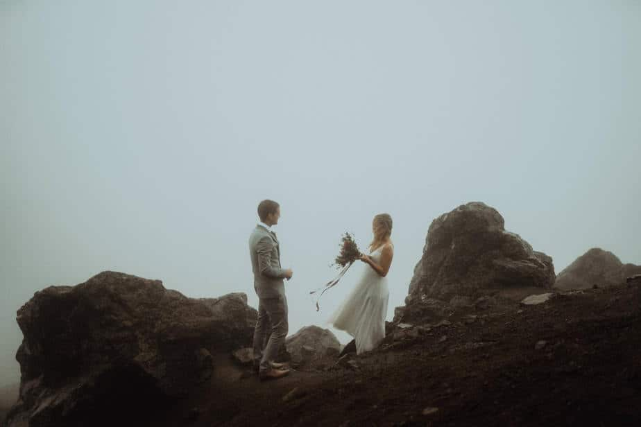 Couple reading their vows on The Old Man of Storr, during Isle of Skye Elopement.