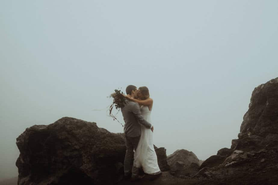 Couple kissing on top of Old Man of Storr during Isle of Skye Elopement