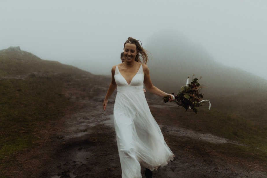 Couple Running in the rain on Old Man of Storr during elopement