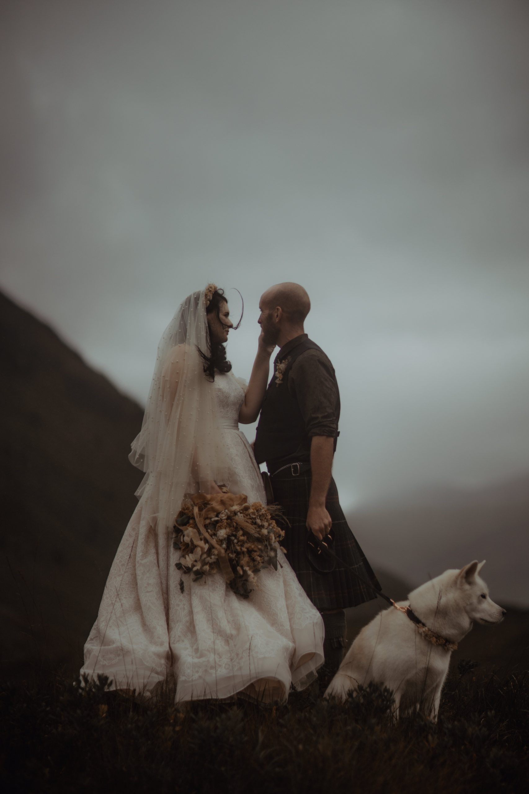 couple with husky during Glencoe. Etive Elopement
