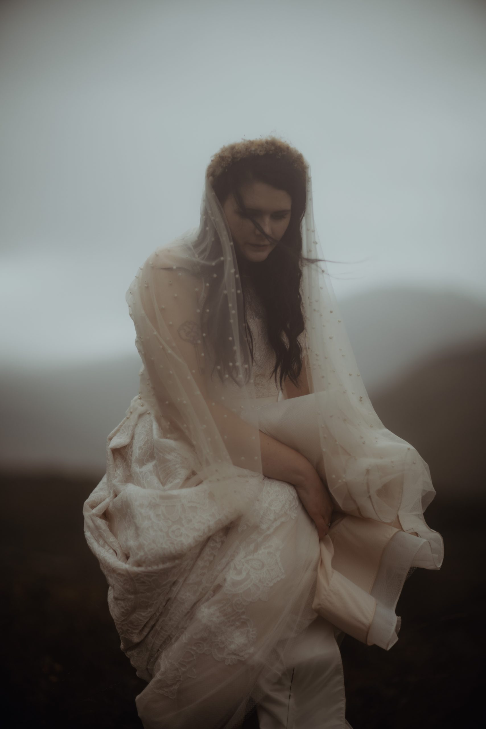 Lucy holding dress, eloping at Glen Etive
