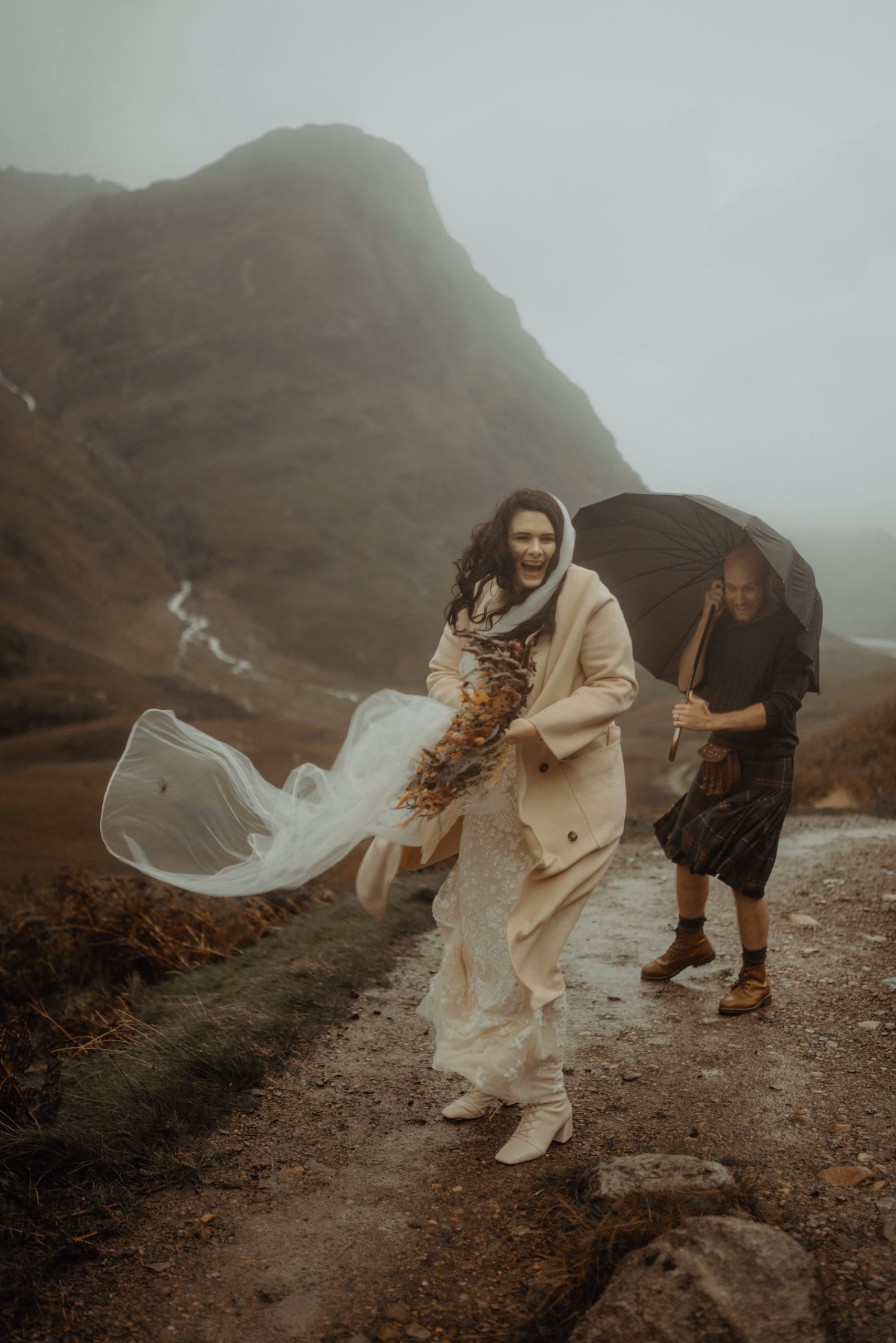couple with veil blowing in the wind during Glen Etive