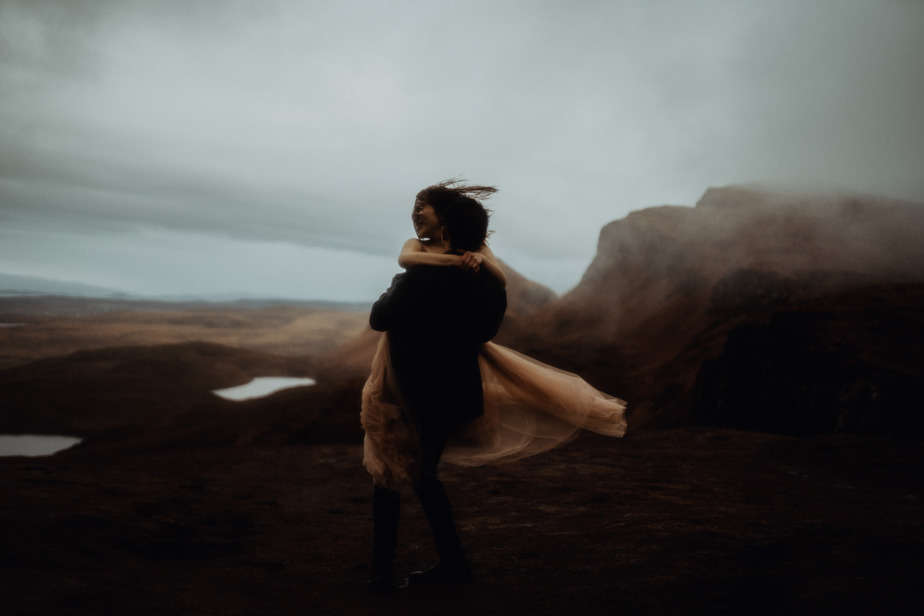 man picking up woman at The Quiraing by Isle of Skye Wedding Photographer