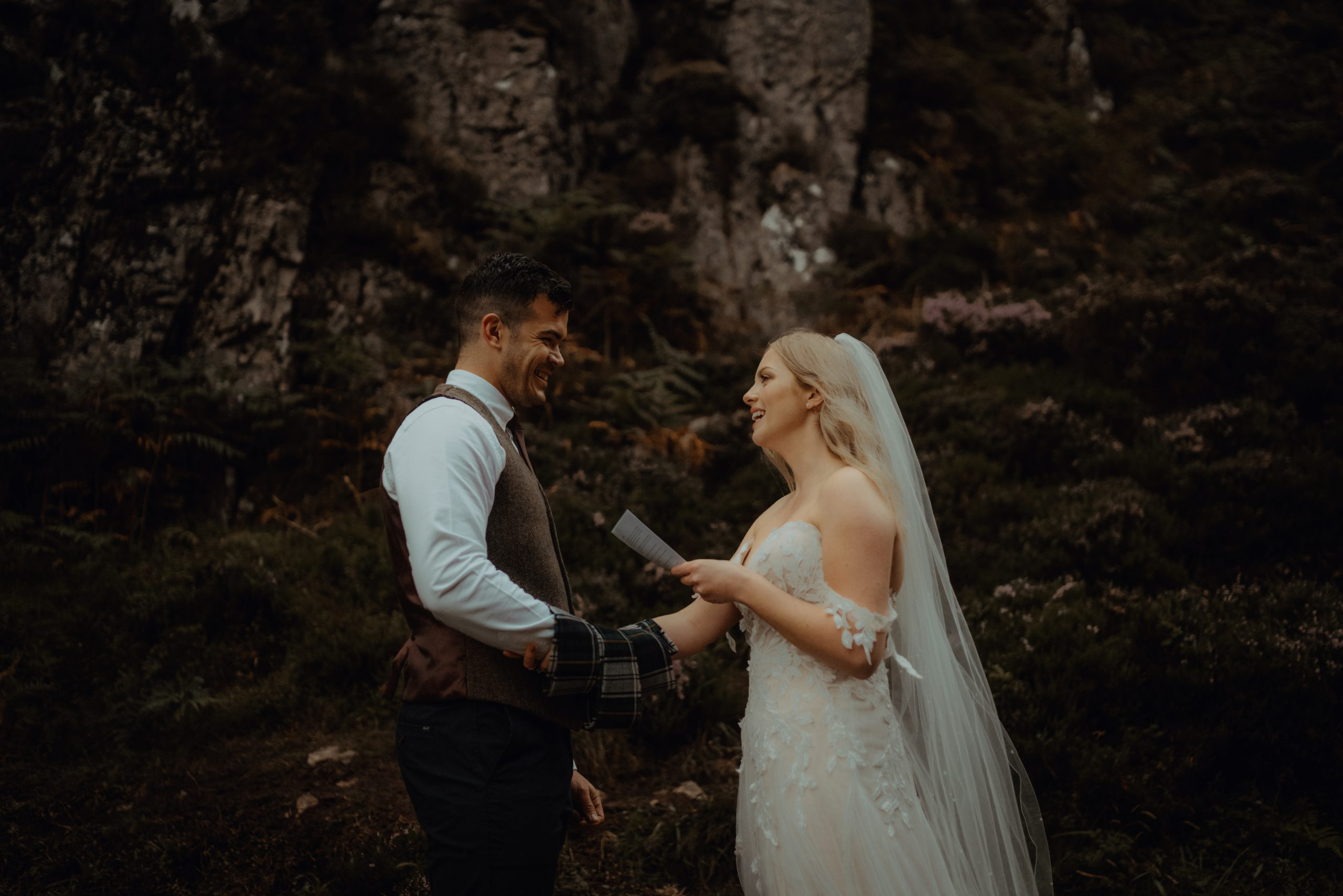 couple reading vows during elopement ceremony at Wailing Widow Falls