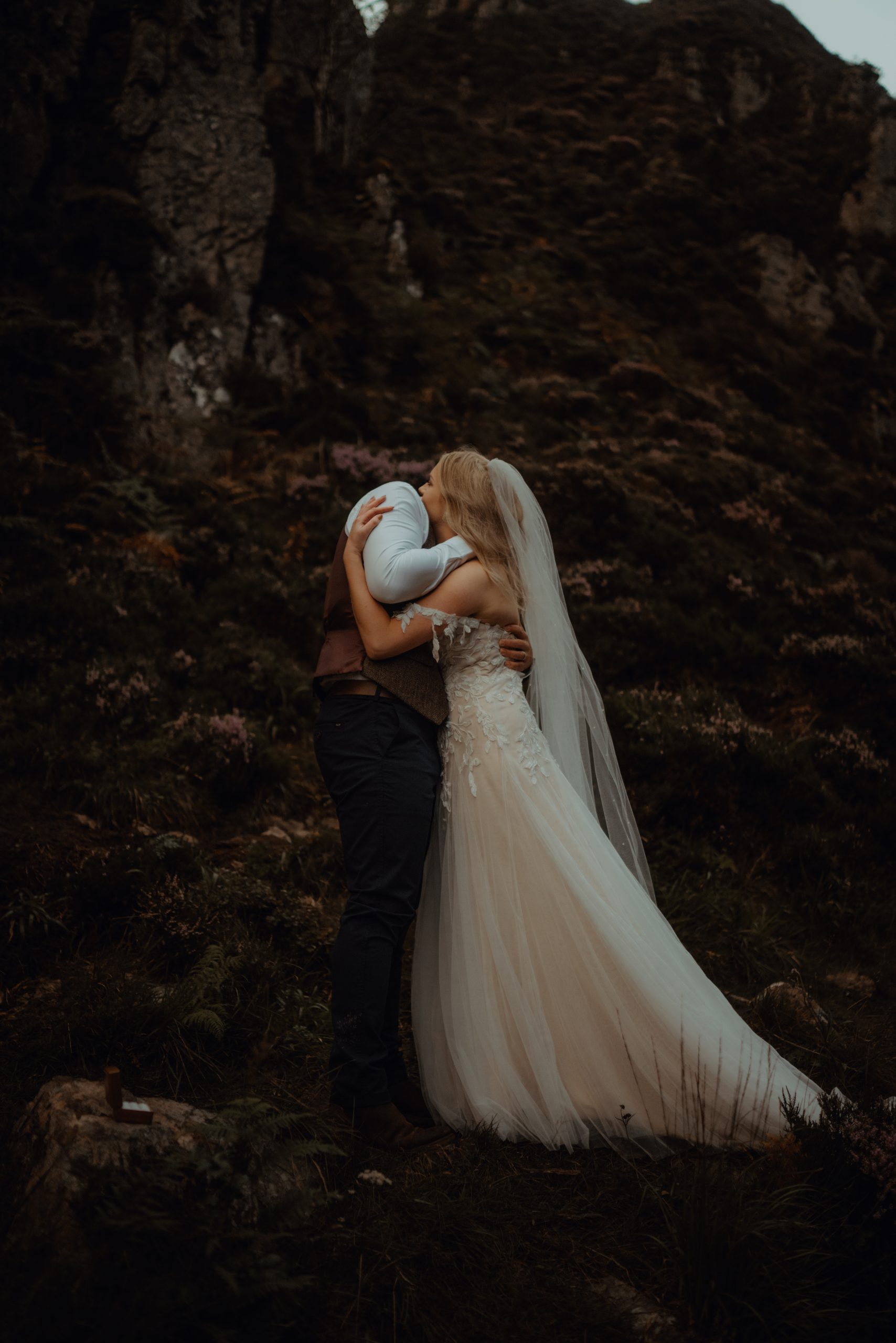 couple hugging at elopement ceremony at Wailing Widow Falls