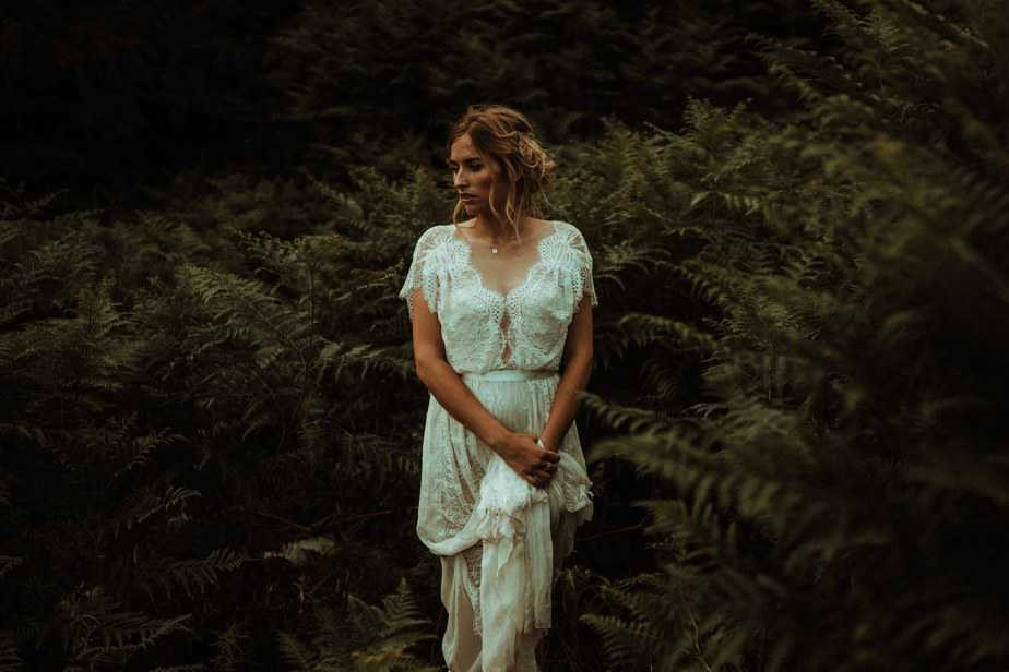 Bride stood in Ferns by Lake District Wedding Photographer Belle Art Photography
