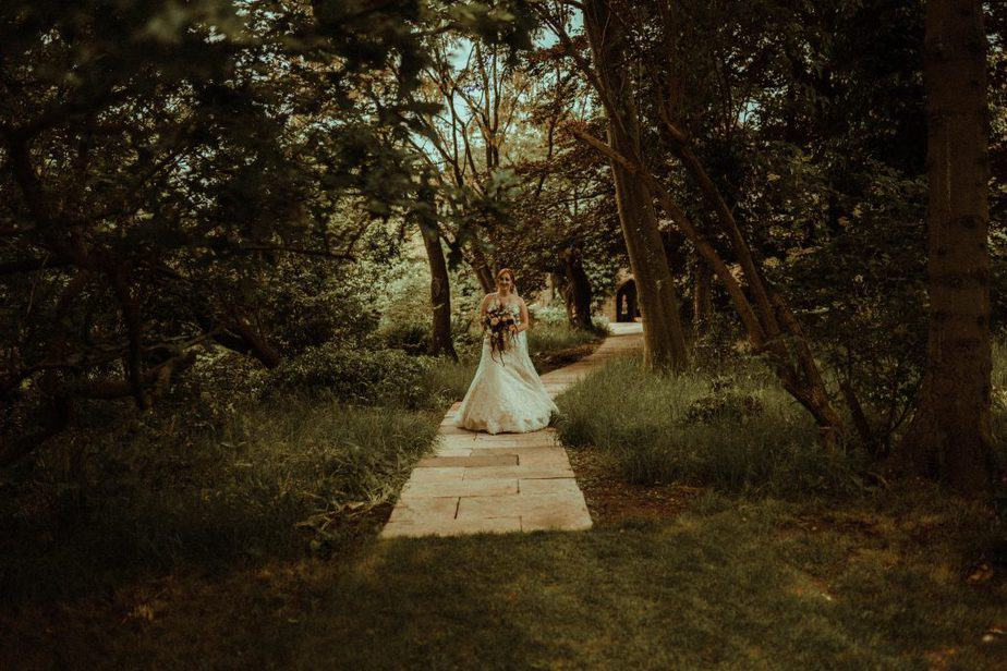 An image of the bride walking down the aisle at Crook Hall by Belle Art Photography