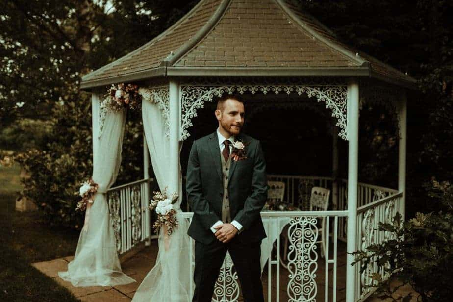 An Image of the groom at the alter at Crook Hall by Belle Art Photography