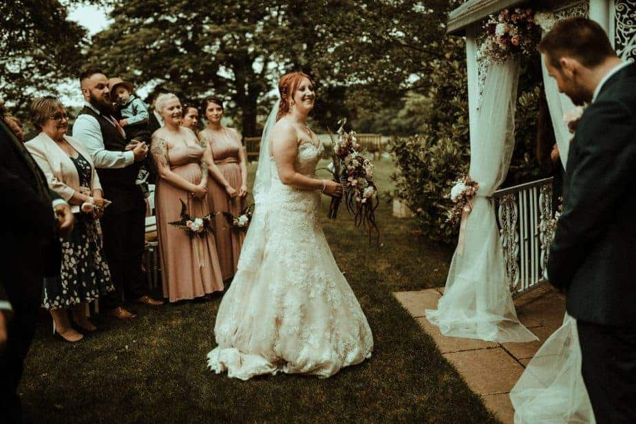 An image of the bride at the alter at Crook Hall by Belle Art Photography