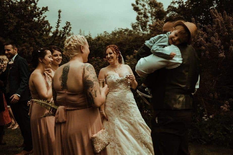 An image of a group of guests laughing at Crook Hall by Belle Art Photography