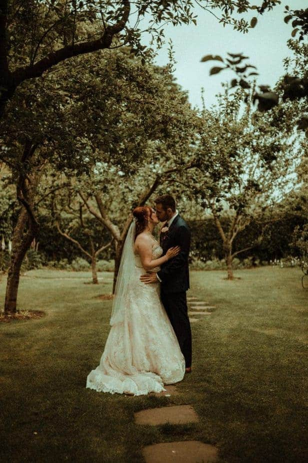 An image of bride and groom kissing at Crook Hall by Belle Art Photography