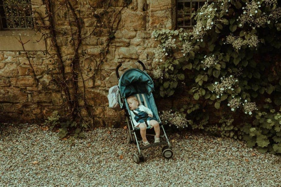 An image of a child asleep in the pram at Crook Hall and Gardens
