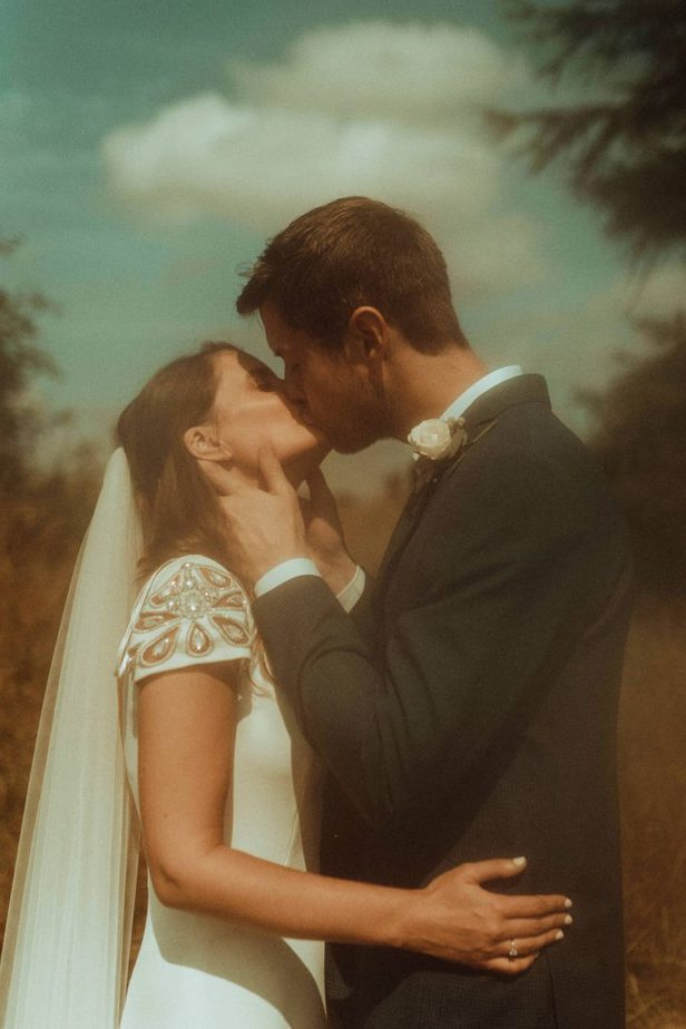 An image of a couple kissing at an intimate wedding at Northside Farm by Belle Art Photography