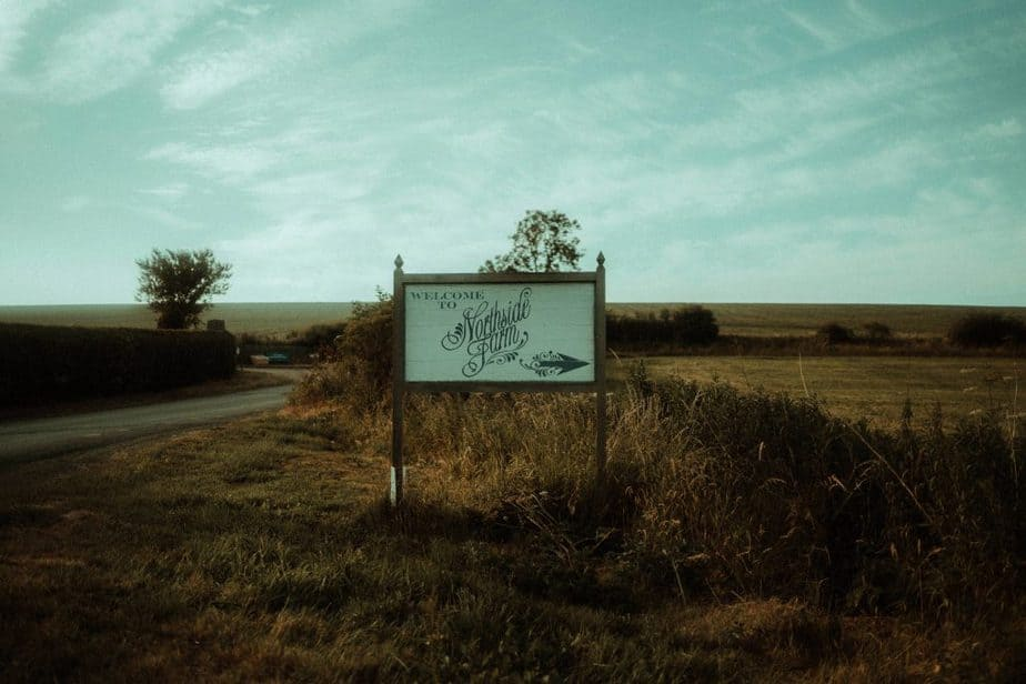 An image of the venue road sign at an intimate wedding at Northside Farm by Belle Art Photography