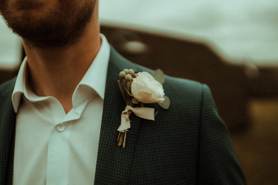 An image of groom with buttonhole an intimate wedding at Northside Farm by Belle Art Photography