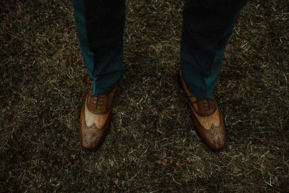 An image of grooms shoes an intimate wedding at Northside Farm by Belle Art Photography