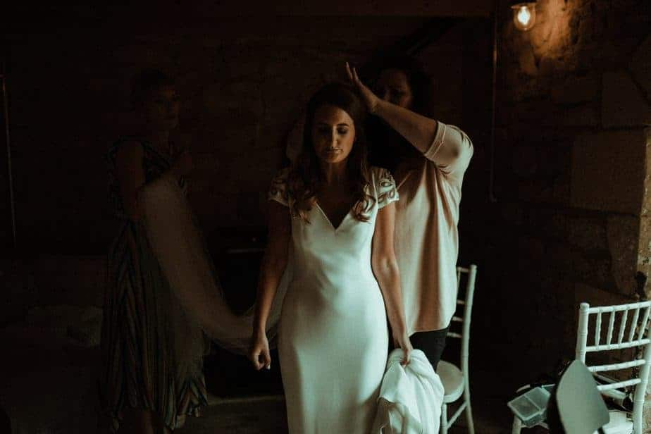 An image of bride getting veil on an intimate wedding at Northside Farm by Belle Art Photography