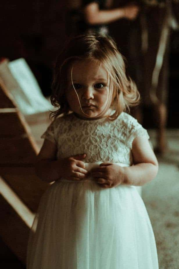 An image of flower girl an intimate wedding at Northside Farm by Belle Art Photography