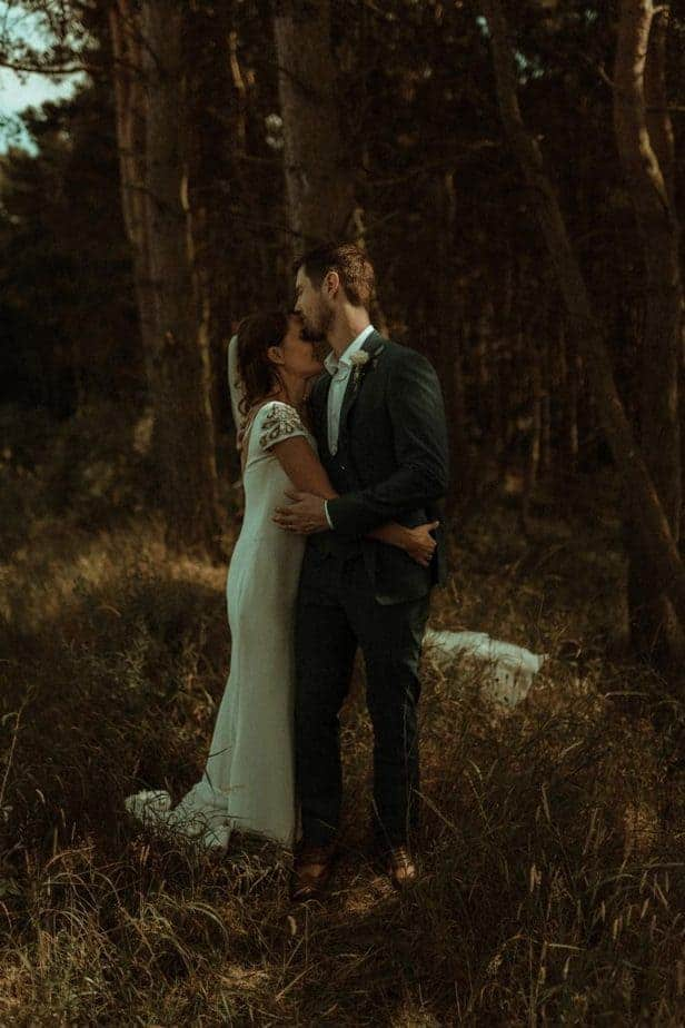 An image of bride and groom hugging an intimate wedding at Northside Farm by Belle Art Photography