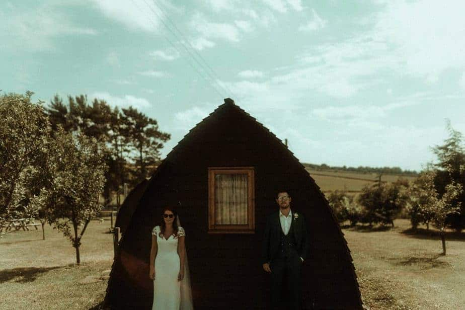 An image of bride and groom outside camping hut an intimate wedding at Northside Farm by Belle Art Photography
