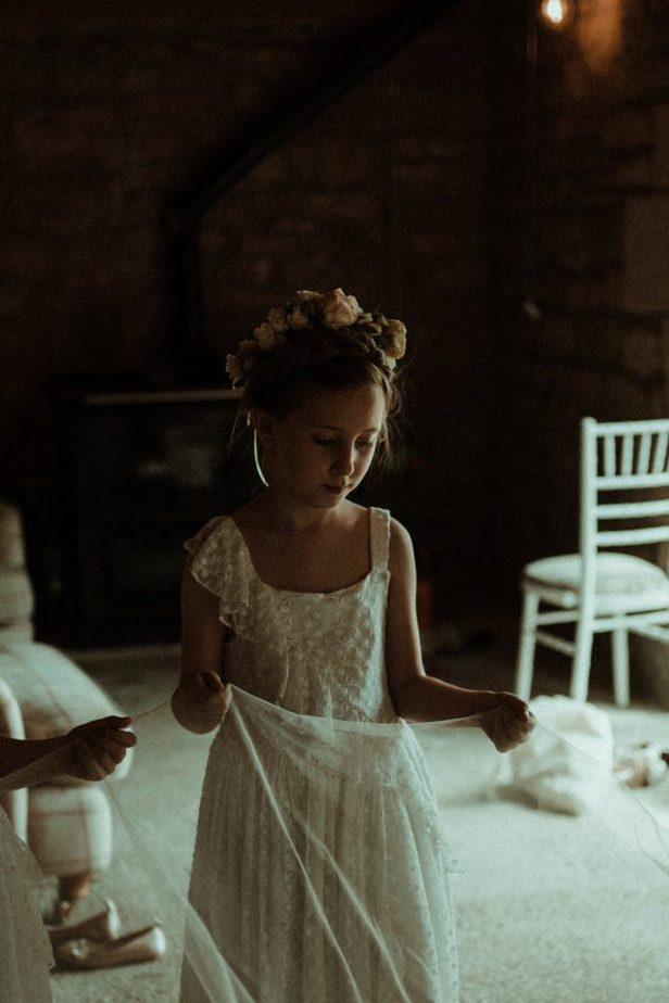 An image of flower girl holding veil an intimate wedding at Northside Farm by Belle Art Photography