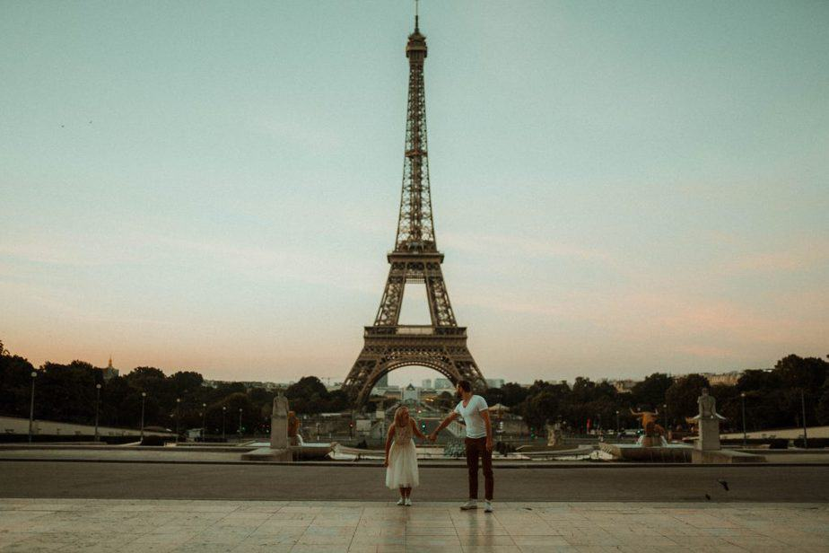 Couple running to Eiffel Tower Paris Engagement Shoot by Belle Art Photography