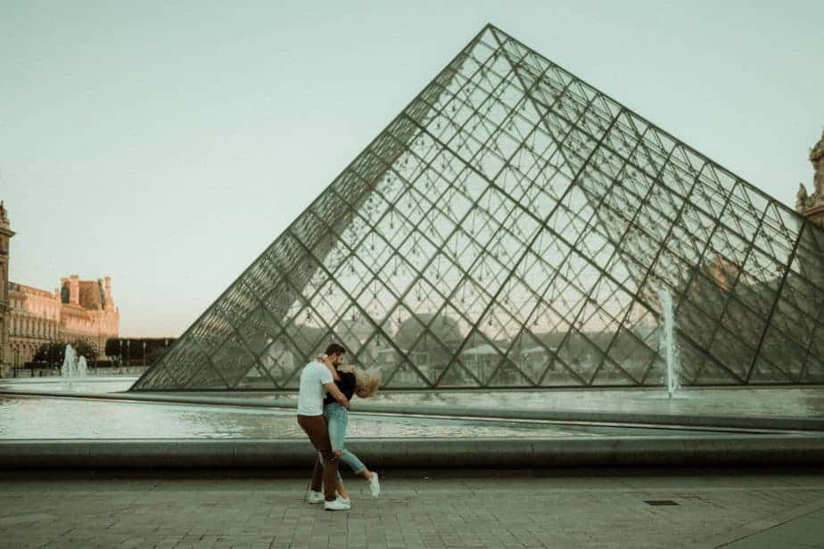 A couple at The Louvre alone in Paris Engagement Shoot by Belle Art Photography