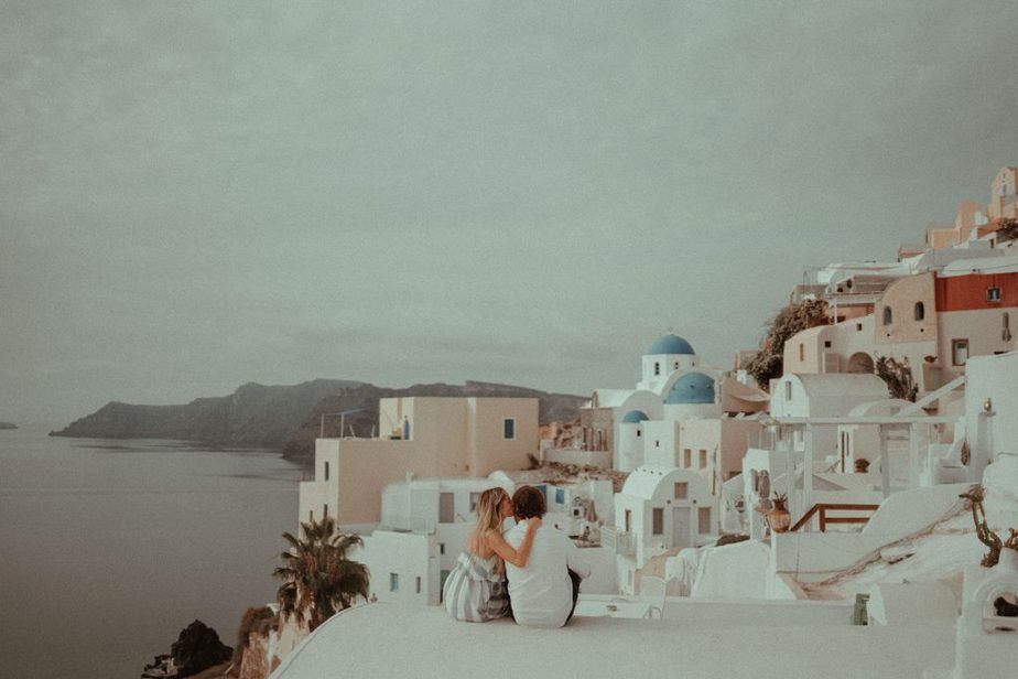 Couple Sat on top of Santorini rooftop during Adventure Session