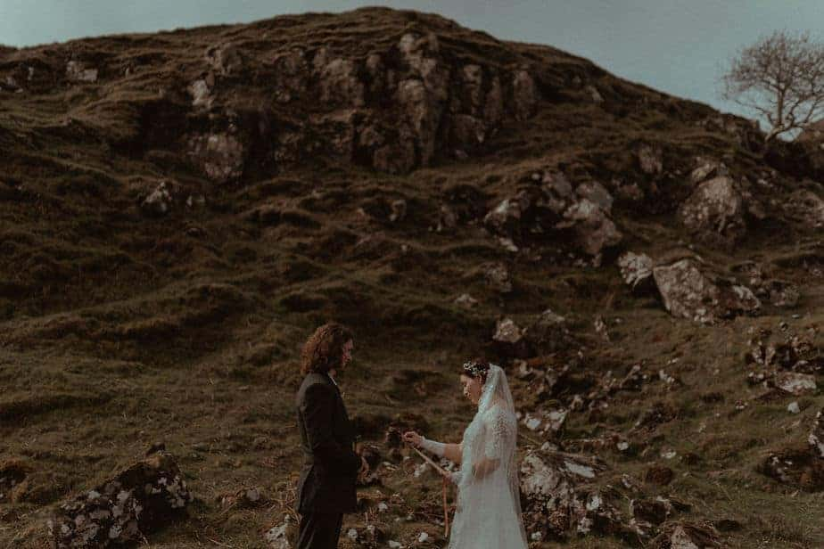 Couple reading vows during Fairy Glen Elopement, Isle of Skye.