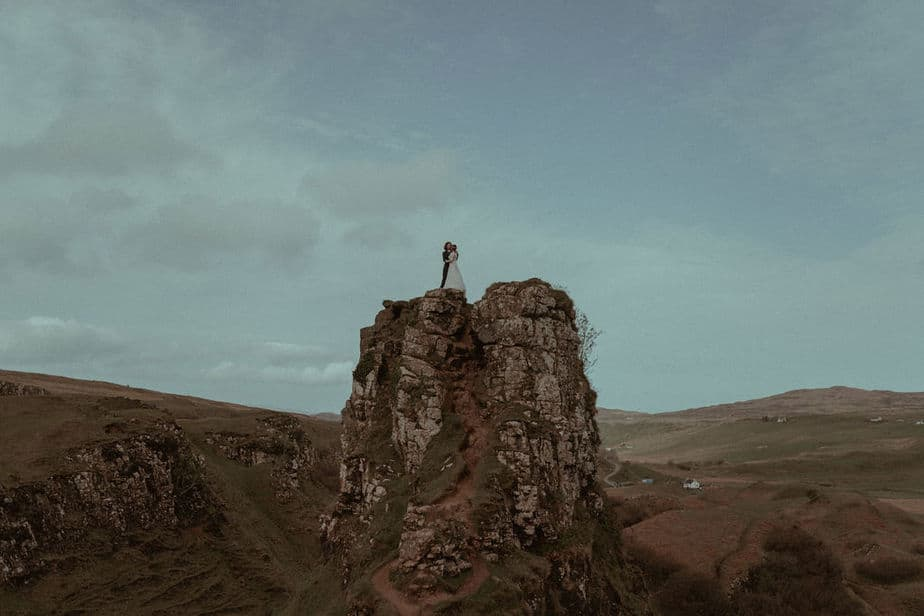 Couple stood on top of Castle Ewan in during Fairy Glen Elopement