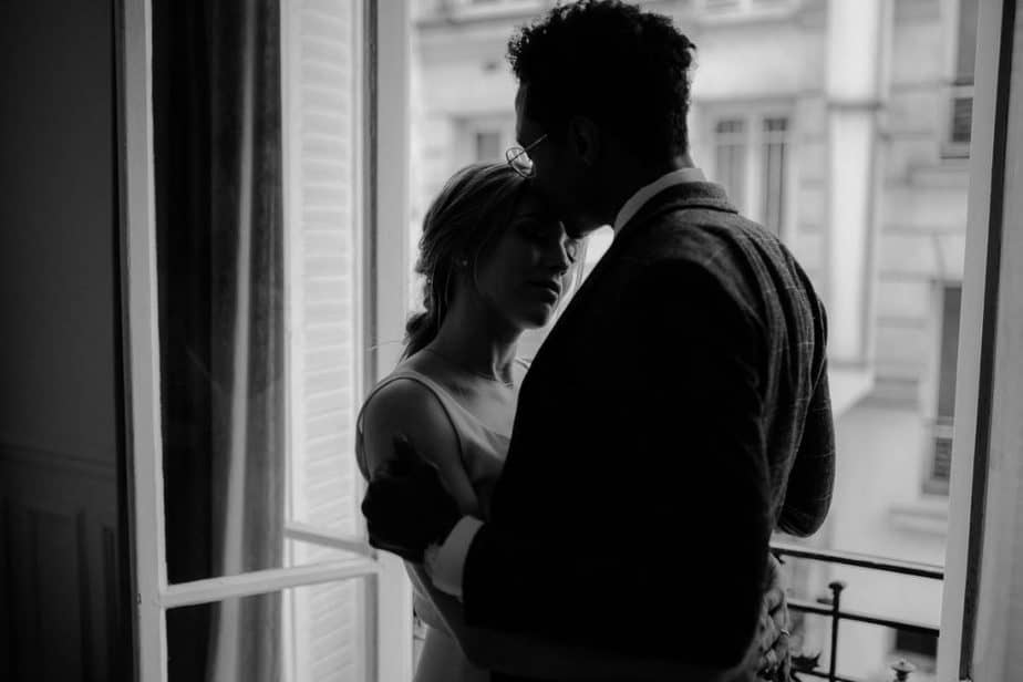 Couple hugging in apartment before elopement ceremony in Paris