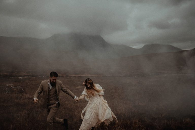 Couple eloping in Glencoe - Running through the mist.