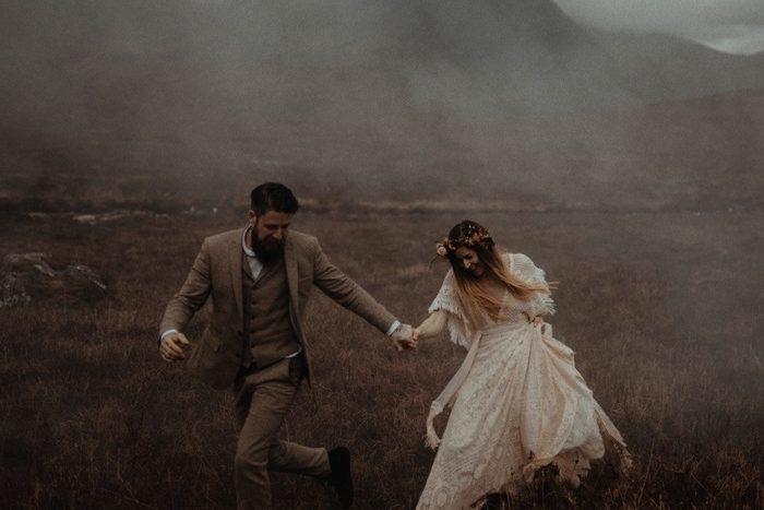 Couple eloping in Glencoe - Running through the mist.
