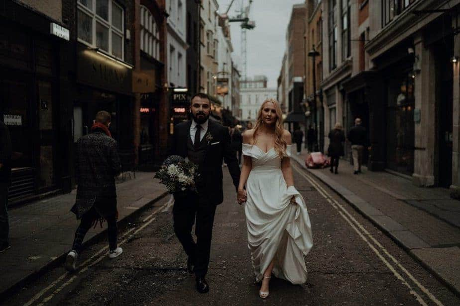 Cool couple walking through Shoreditch to get married - London Elopement Photographer, Belle Art Photography