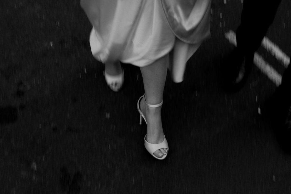 Girl wearing heels walking through London to get married - Shoreditch elopement.
