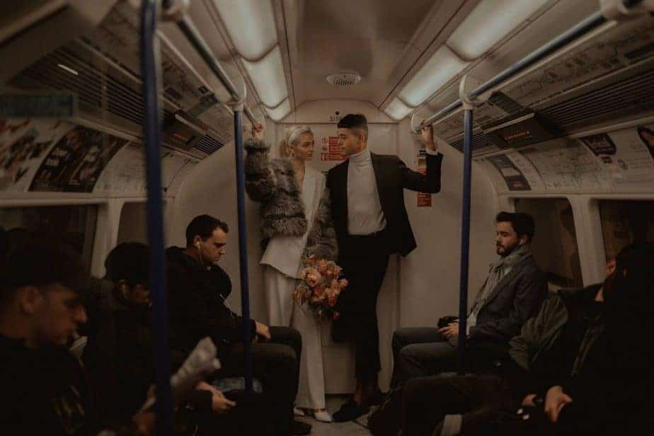 London couple looking at each other on tube during London Elopement