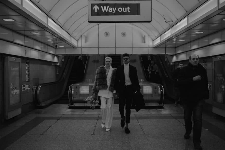 Couple walking out of tube station in Shoreditch during London Elopement - London Elopement Photographer, Belle Art Photography.