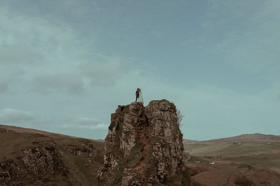 Couple stood on top of mountain at Fairy Glen by Isle of Skye Elopement photographer.