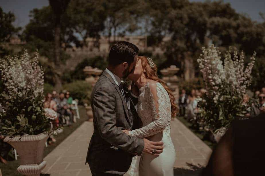 Couple kissing during Wedding ceremony by Malta Wedding Photographer - Belle Art Photography