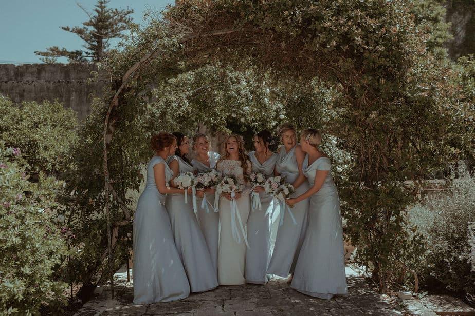 bridesmaids laughing together at Villa Bologna wedding, Malta.