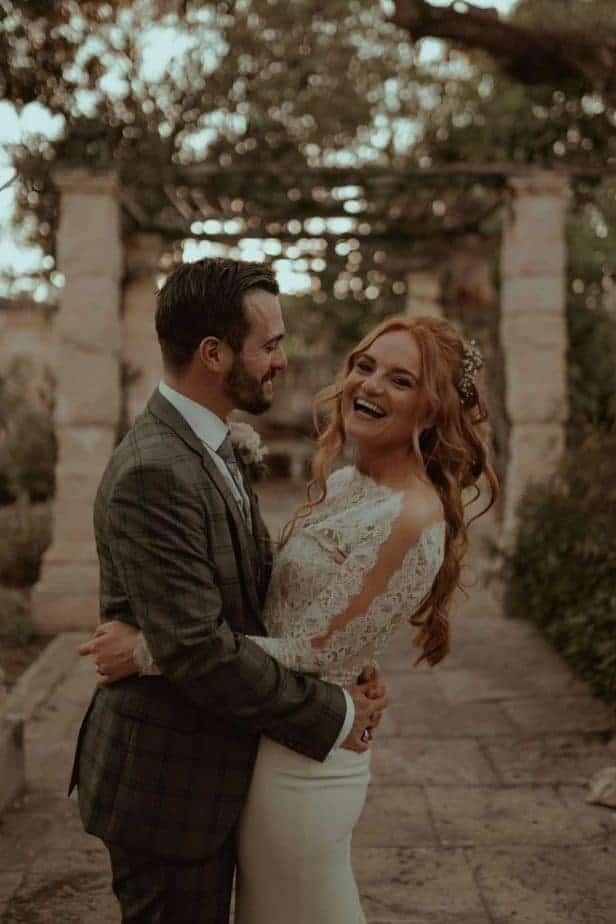Couple laughing together at Villa Bologna, Malta Wedding