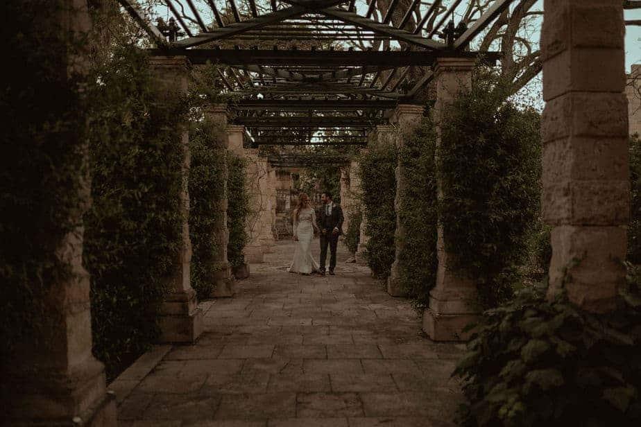 Couple walking through trees at Villa bologna, Malta