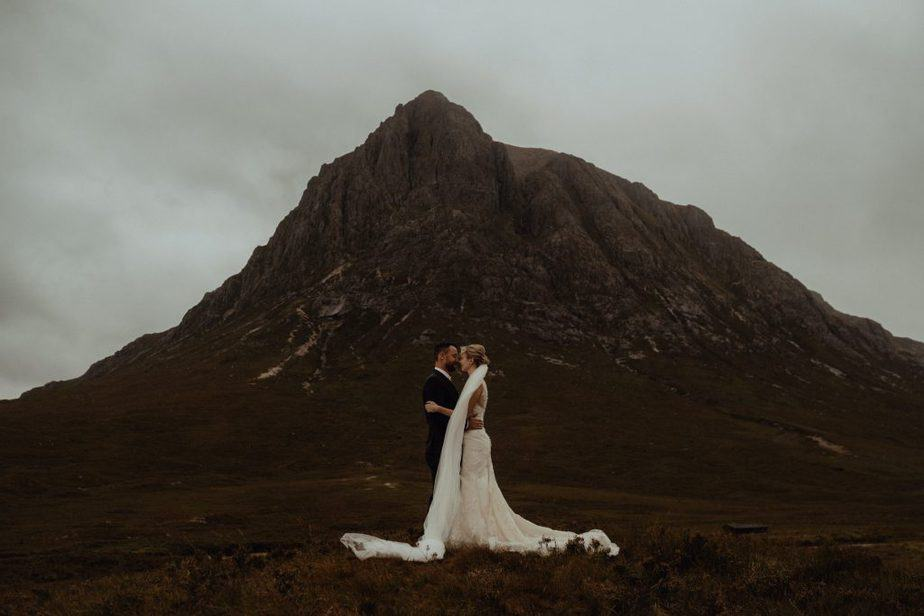 couple posing in front of Glencoe Valley Elopement, Scotland