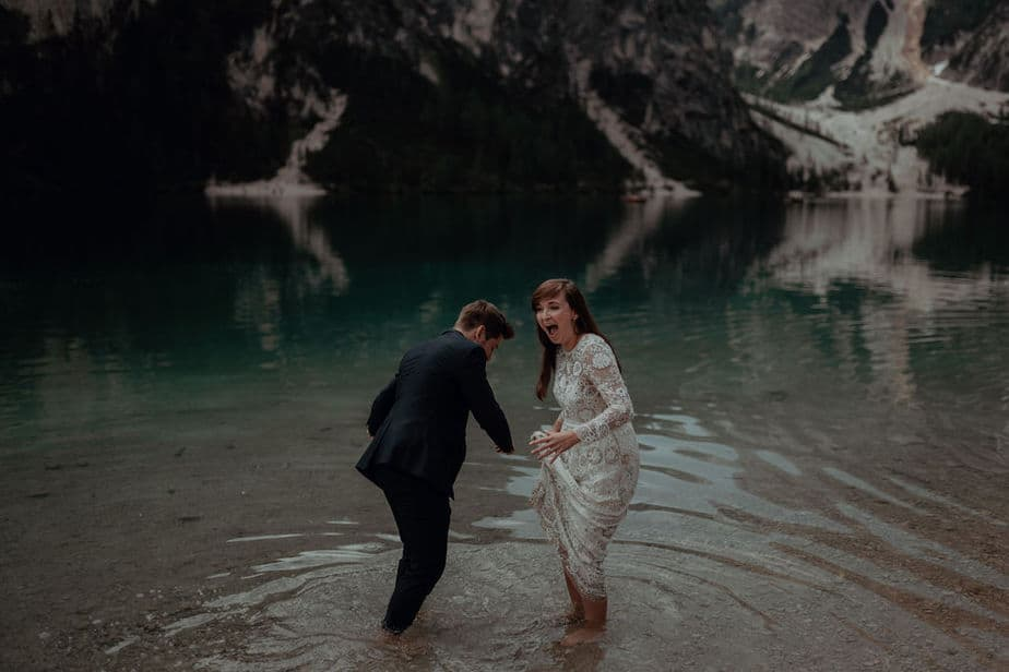 Couple playing the water during Lake Braies Couple Session