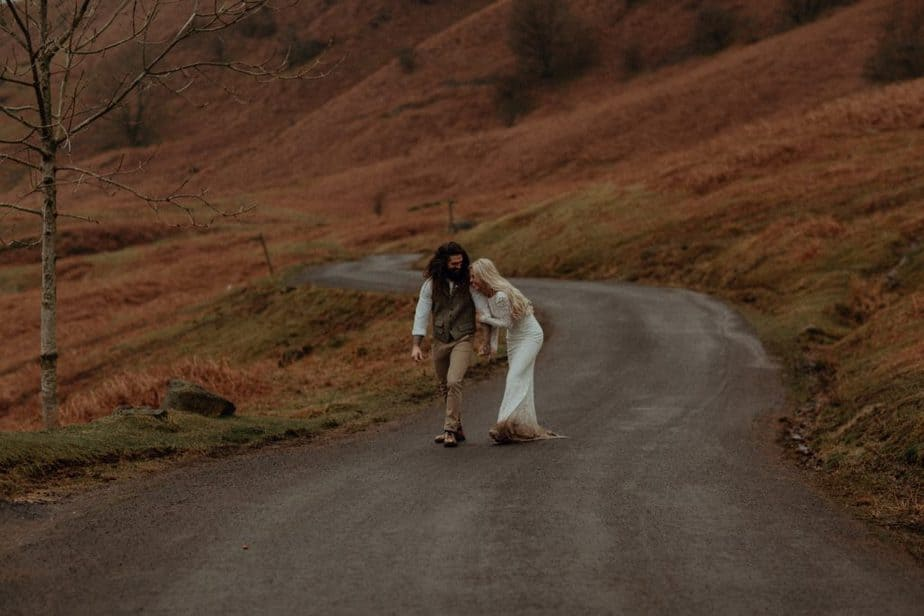 Couple laughing during Wedding Photos in The Lake District